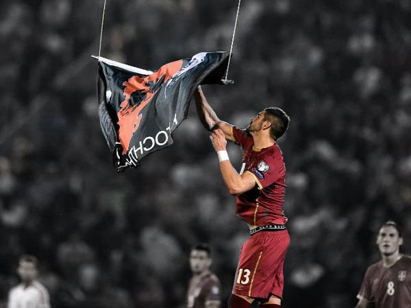 "Player tears down a ""Greater Albania"" flag from drone's undercarriage during tense match"
